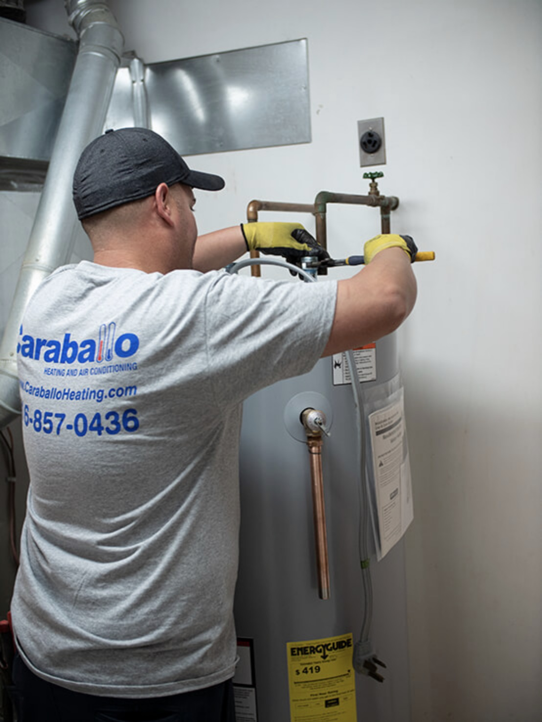 Technician Fixing Water Heater